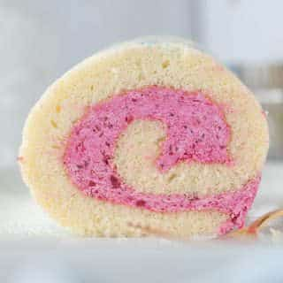 close up of vanilla roll cake with strawberry filling