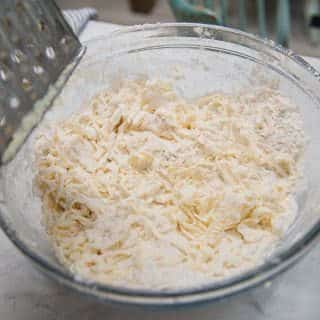 grating cold butter into the flour mixture helps keep the butter cold while you work