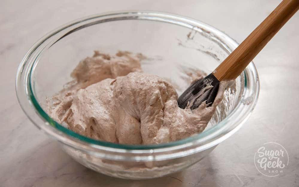 folding almond flour mixture into egg white mixture