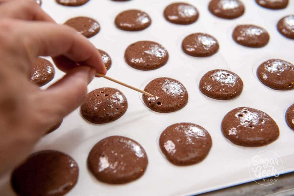 popping bubbles in chocolate macaron batter