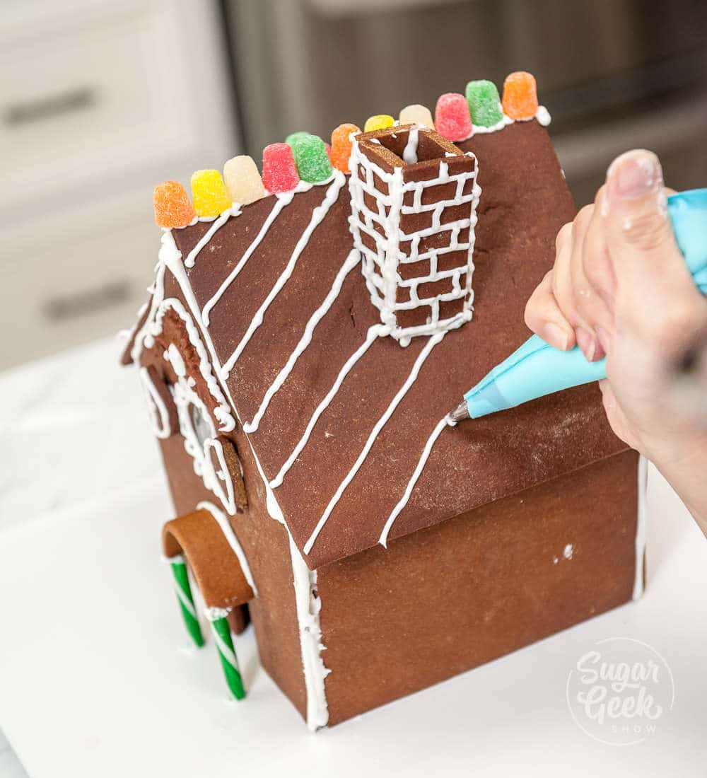 decorating the curved roof gingerbread house
