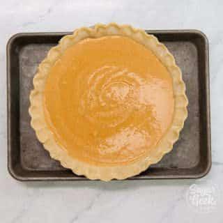 pumpkin pie on sheet pan to prevent spilling