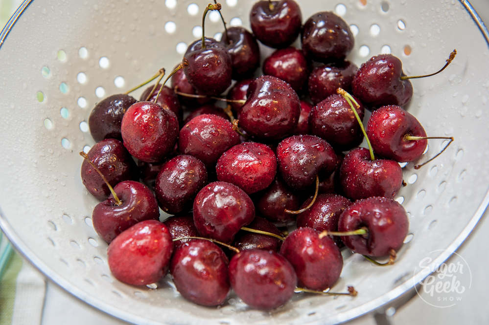 fresh cherries in a white colander