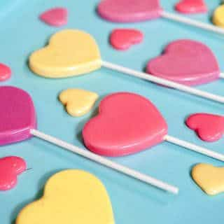 heart lollipops on a blue background
