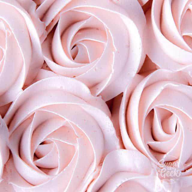 Italian meringue buttercream rosettes on a cake