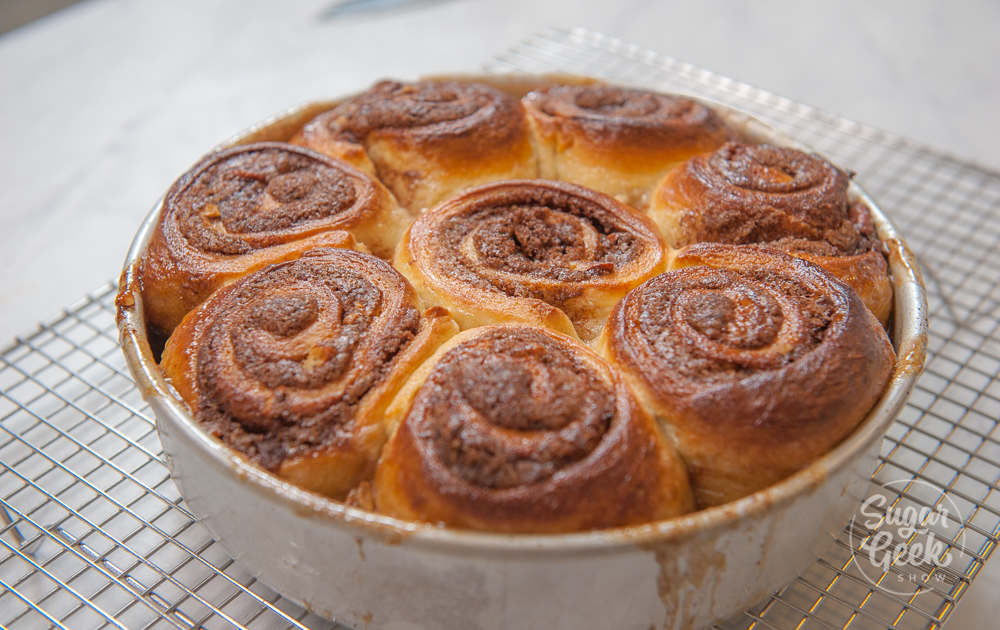 sticky buns in the pan before being flipped out onto a plate