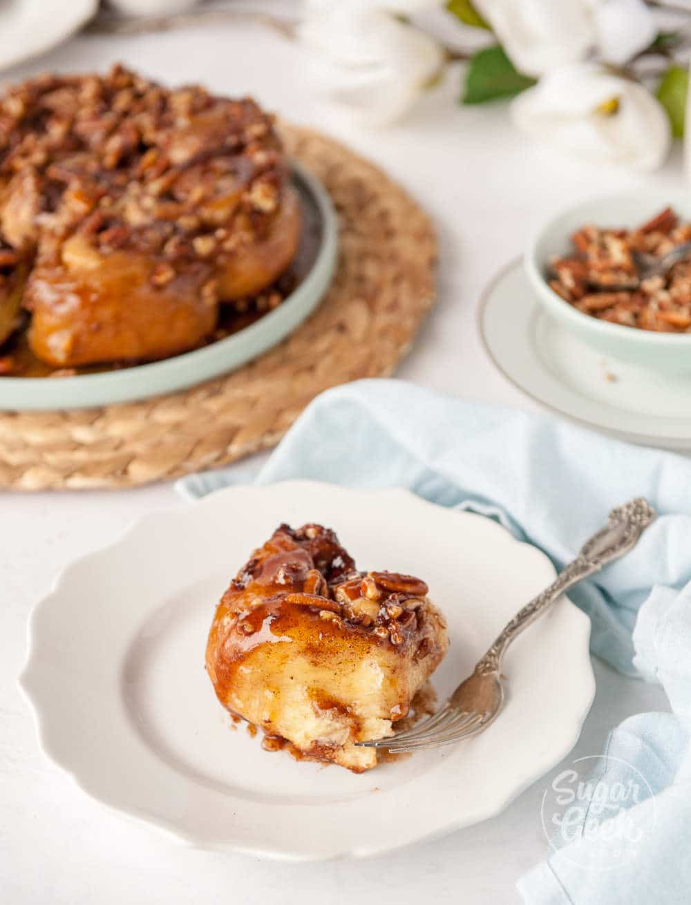 homemade sticky buns on a white plate