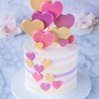 heart lollipop cake on white marble background