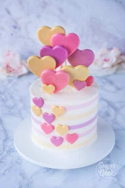 heart lollipop cake on white marble background