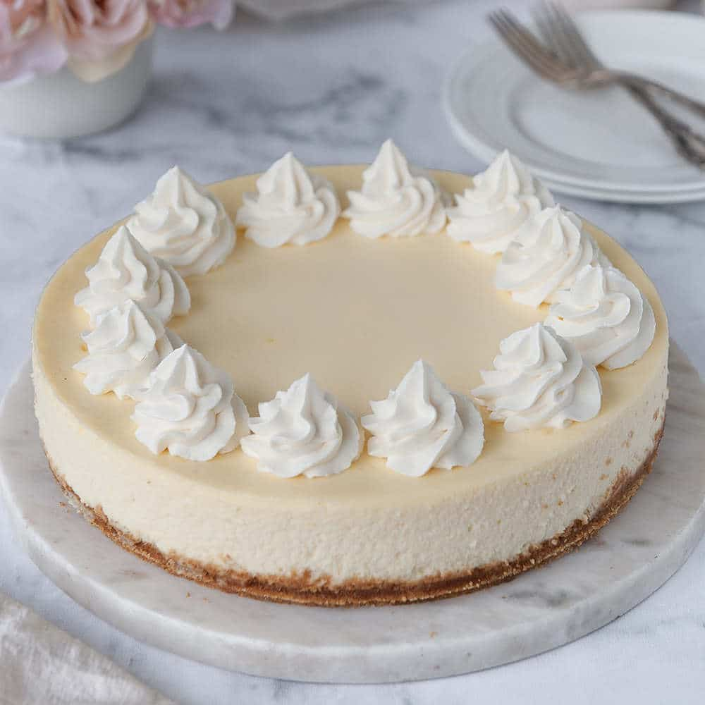 perfect cheesecake with no browning or cracks. Whipped cream piped on top