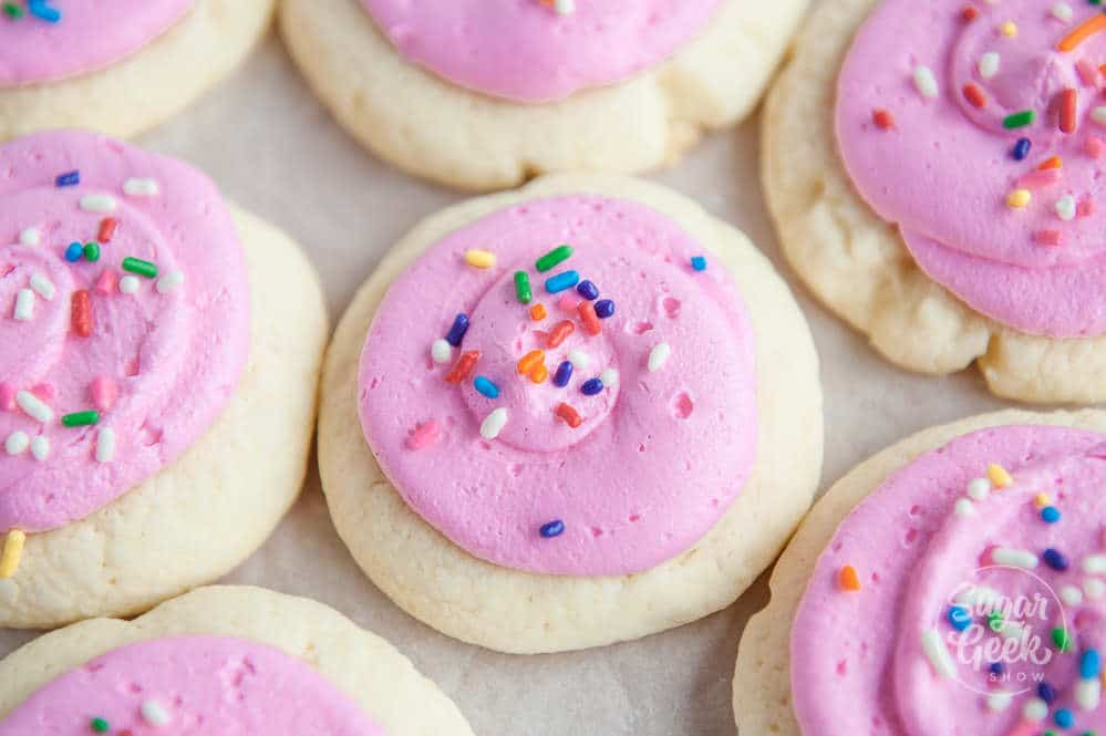 copycat lofthouse cookies with pink buttercream frosting and rainbow sprinkles