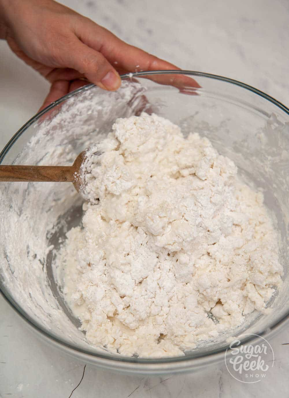 making traditional irish soda bread in a bowl with a wooden spoon