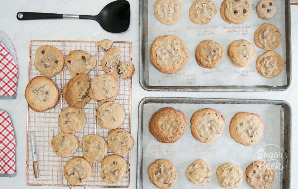 chocolate chip cookie tests on cookie sheets and cooling rack shot from above
