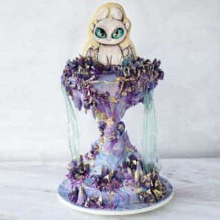 Light Fury Cake with gelatin waterfalls, edible crystals and cookie topper
