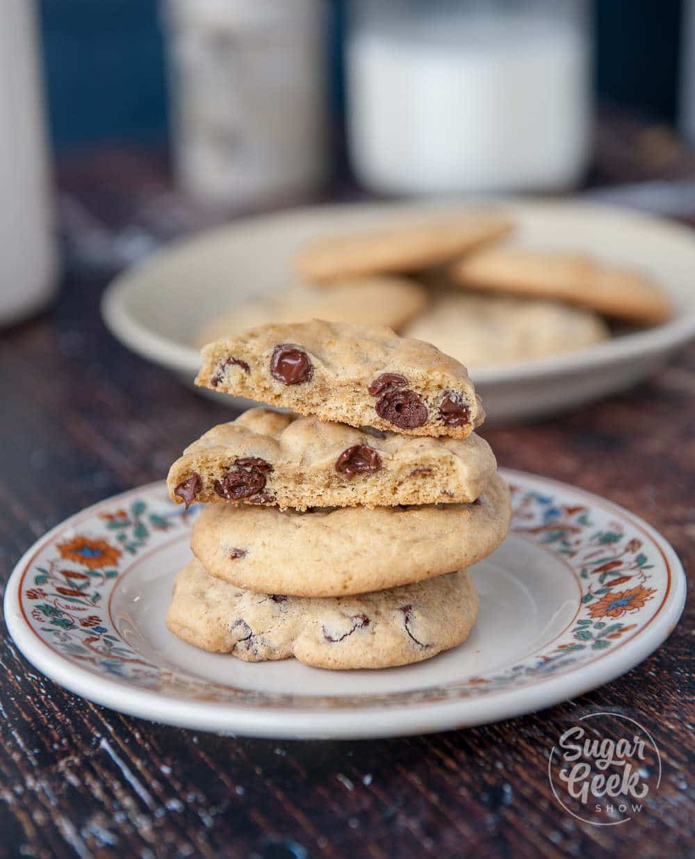chewy chocolate chip cookies on a floral plate on wooden background