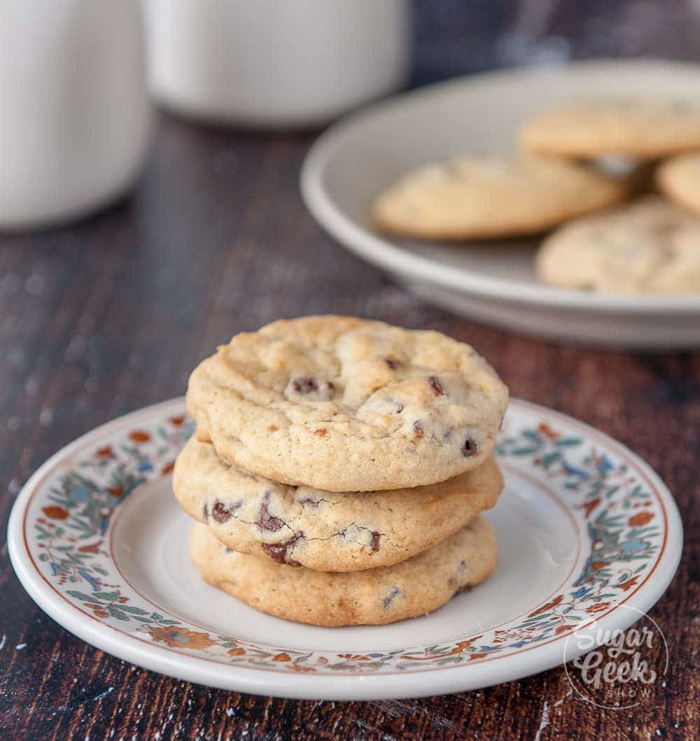 chewy chocolate chip cookies on a floral plate with wooden background