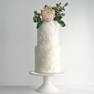 King Protea sugar flower and eucalyptus sugar foliage on white wafer paper wedding cake