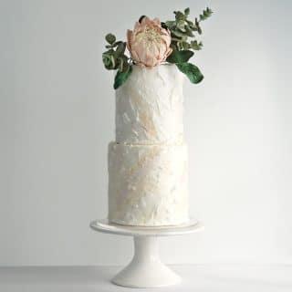 King Protea sugar flower and eucalyptus sugar foliage on white wafer paper wedding cake