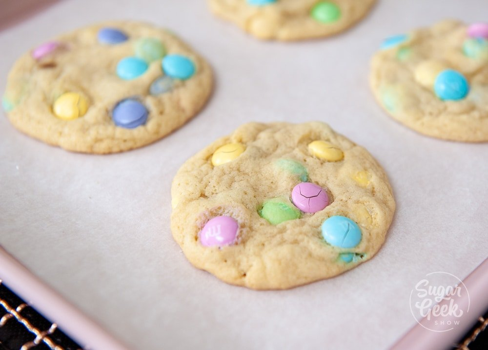 M&M cookies cooling on parchment paper
