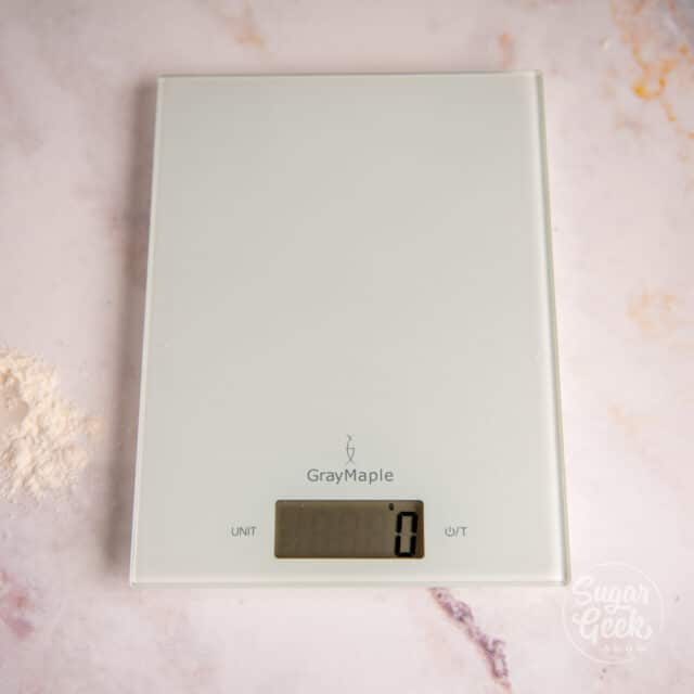 white digital kitchen scale on a white background