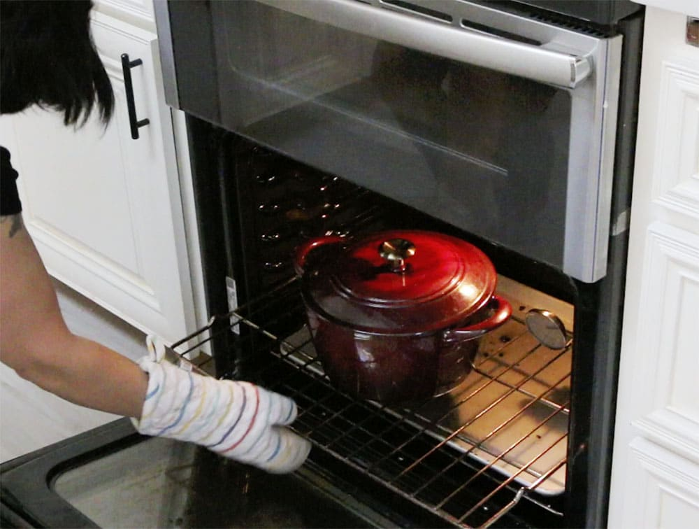preheating dutch oven in a hot oven