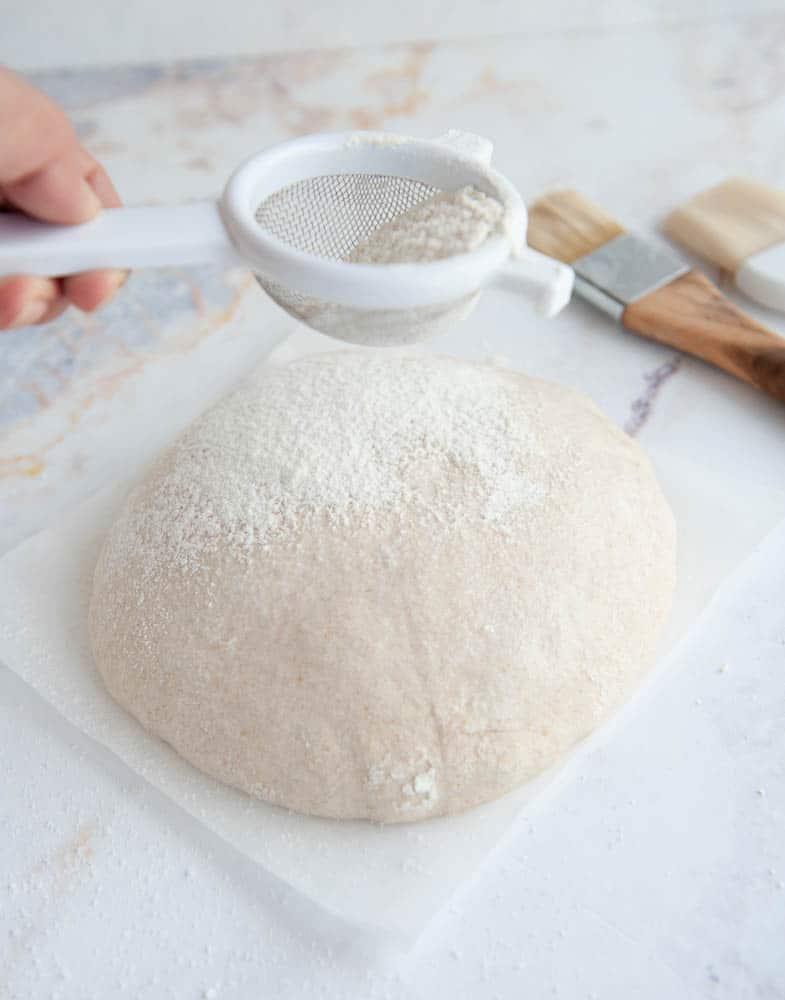 dusting sourdough with flour