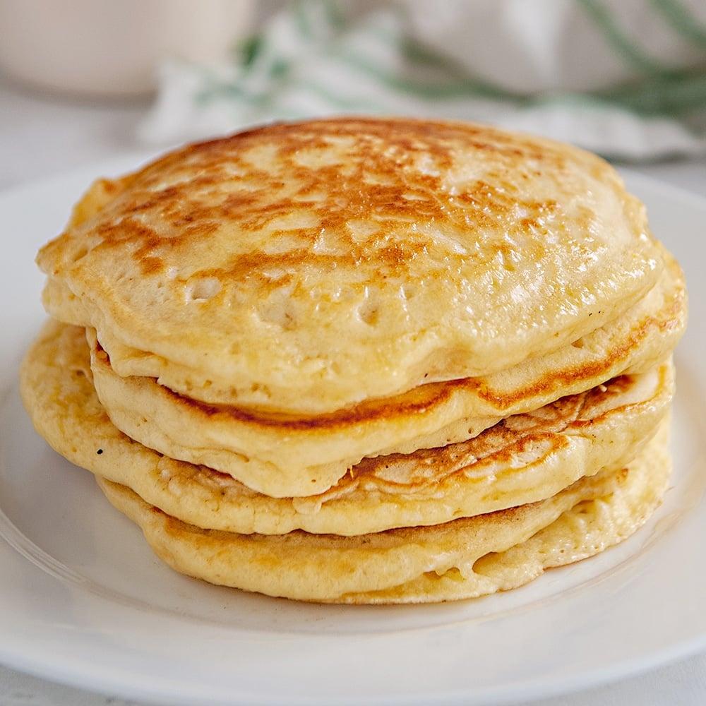 sourdough pancakes on a white plate