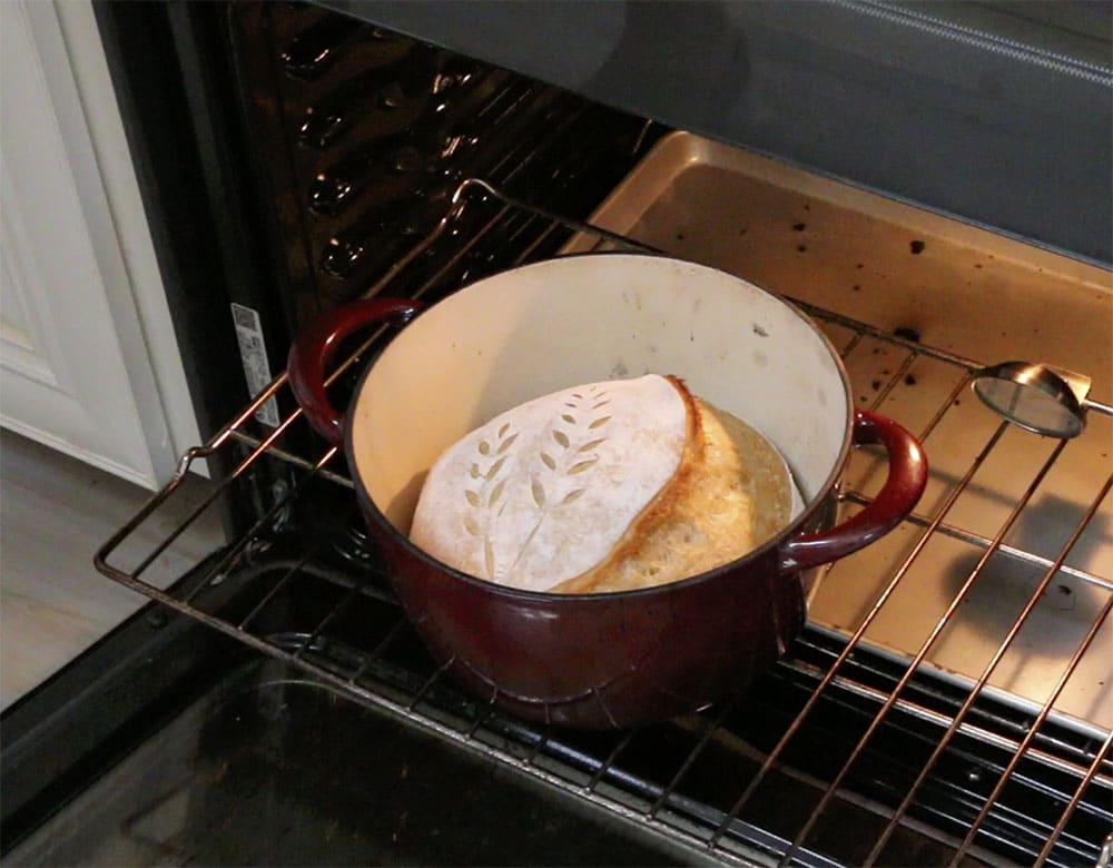 removing the lid from the hot dutch oven
