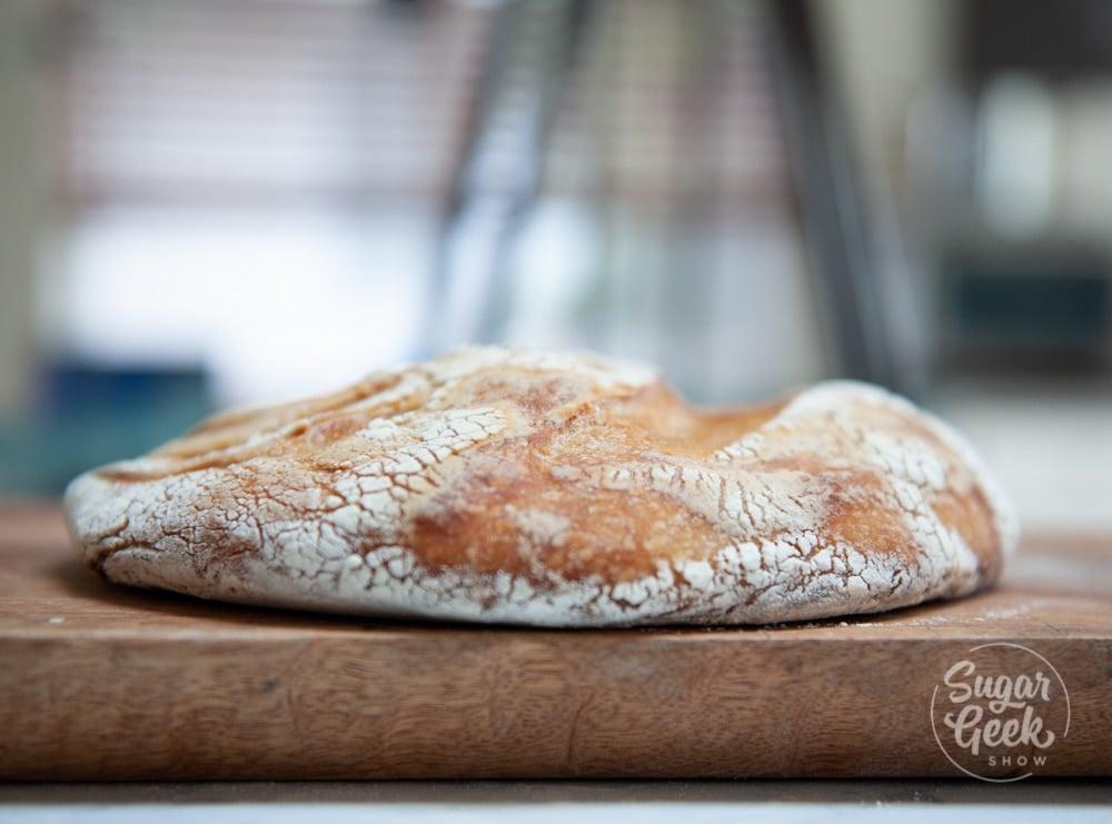flat loaf of sourdough bread