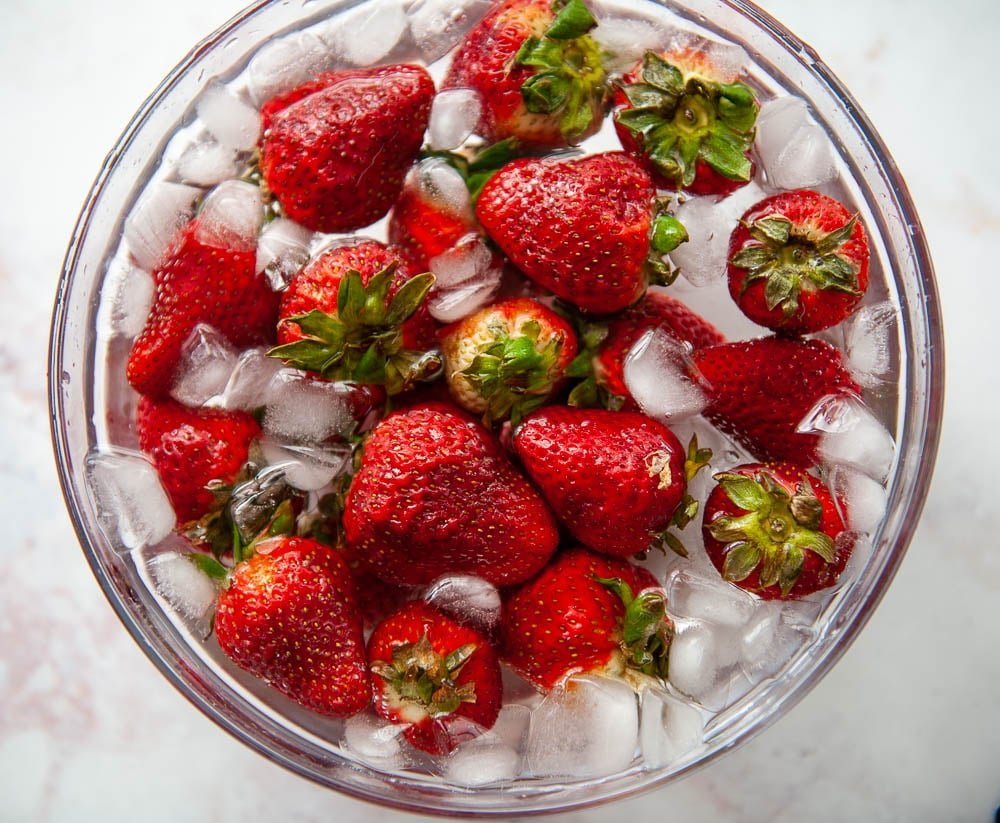 strawberries in ice water