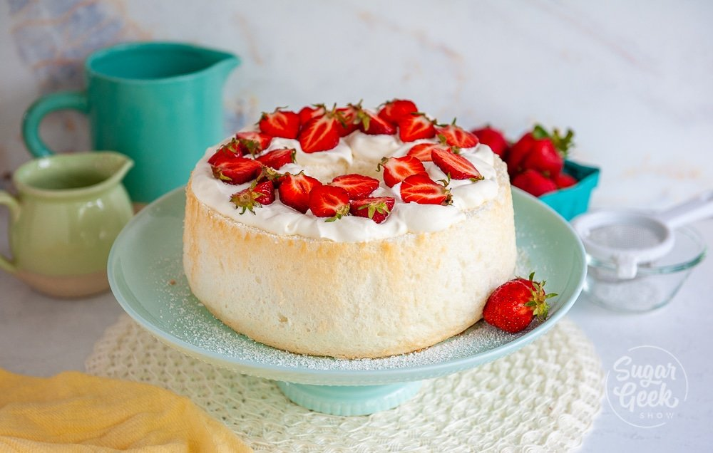 angel food cake topped with whipped cream and strawberries