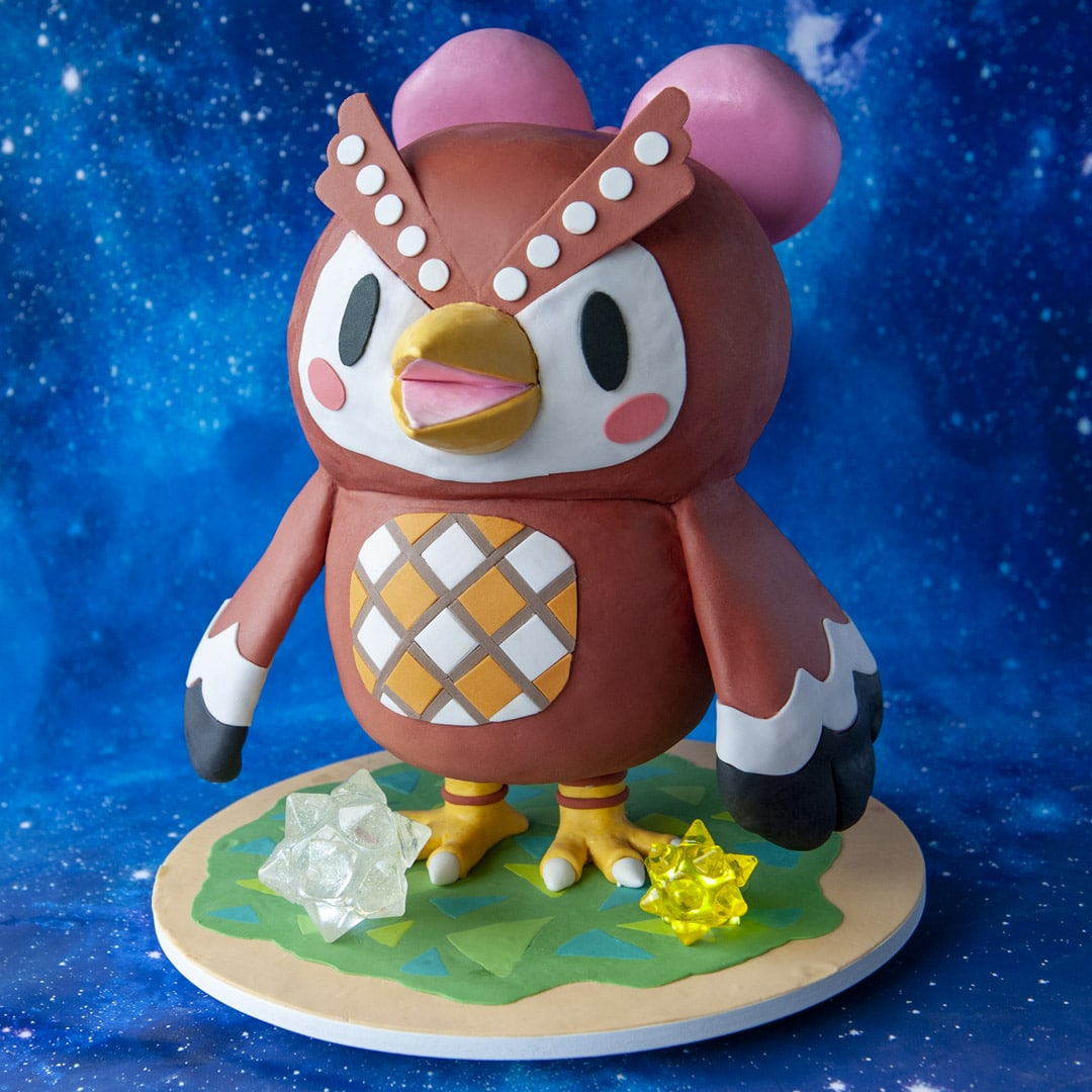 Animal Crossing Celeste Cake with green grass cake board and isomalt star fragments