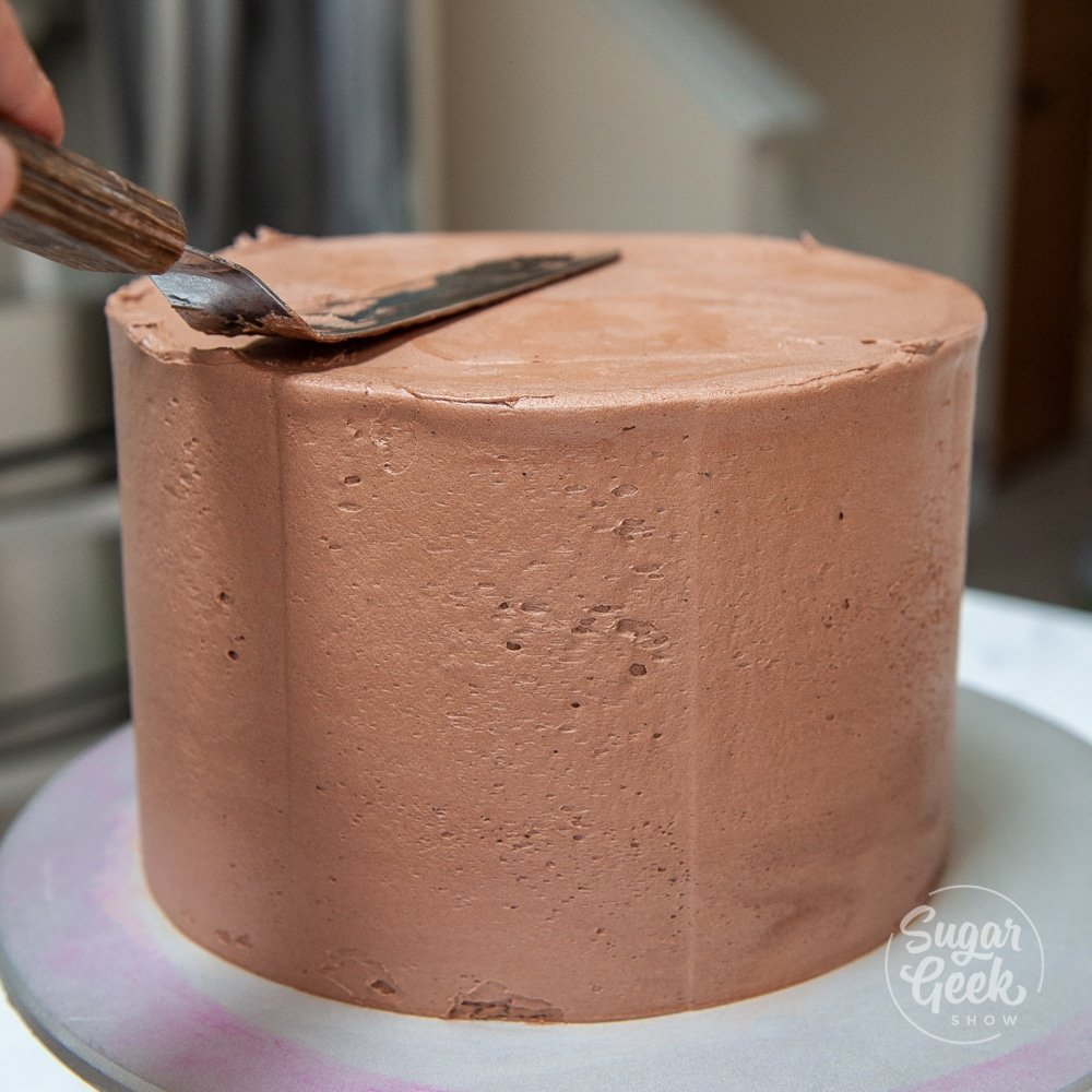 chocolate cake with offset spatula
