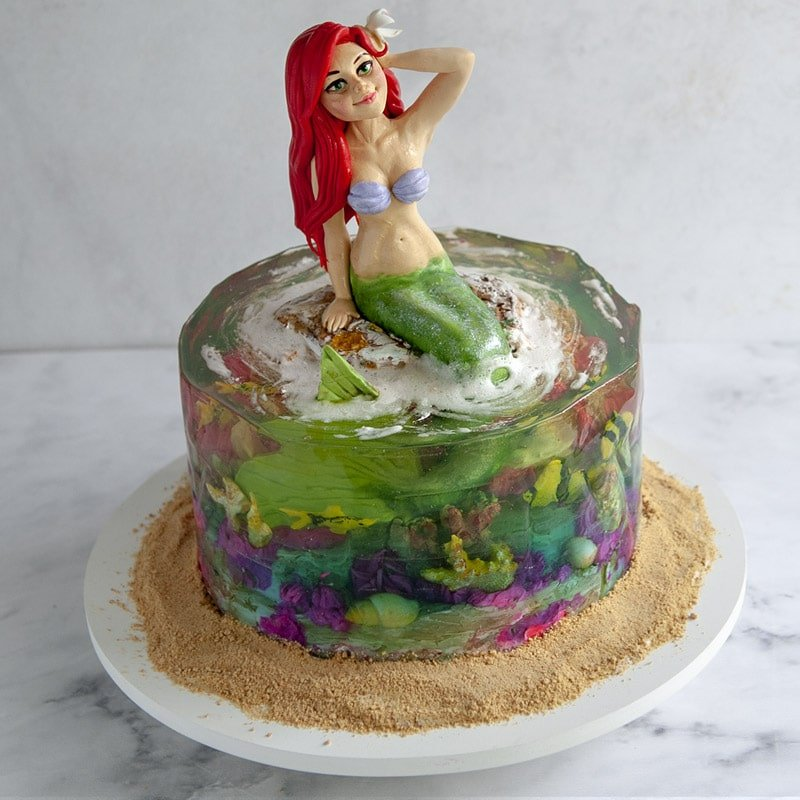 Cake with Mermaid cake topper and clear ocean coral reef gelatin cake
