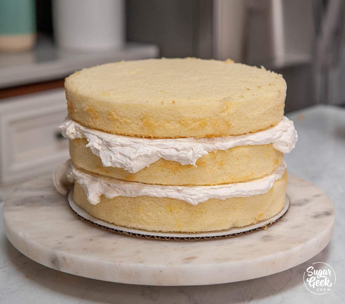 three layers of vanilla cake with vanilla buttercream