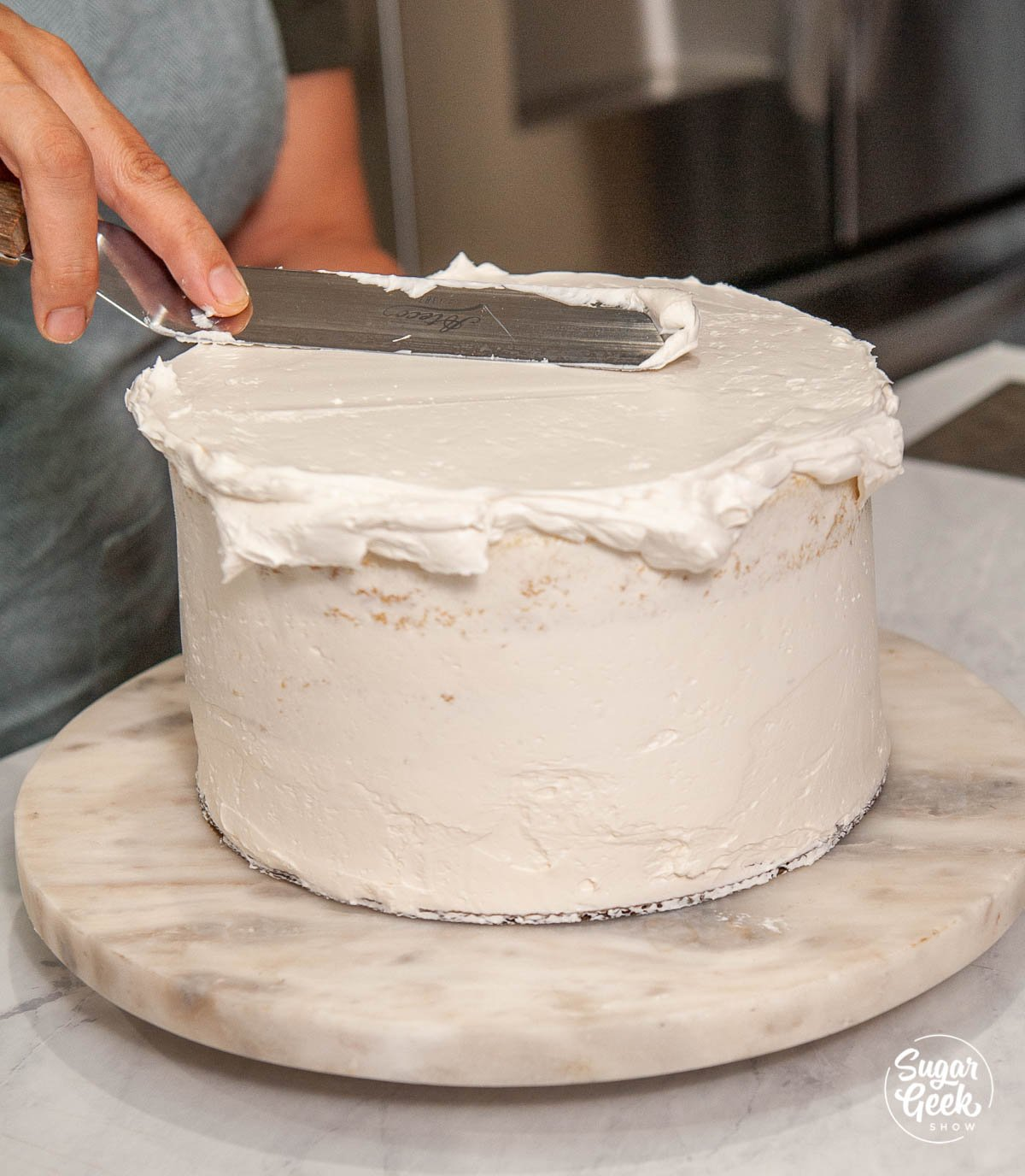 adding the final coat of buttercream