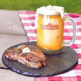 Sculpted cake that looks like realistic beer mug and steak