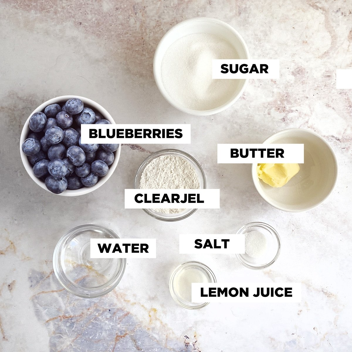 blueberry filling ingredients in individual bowls shot from above