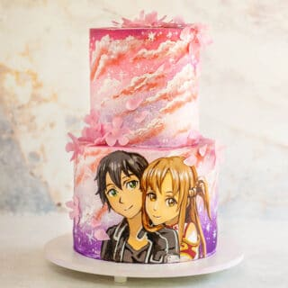 Stacked cake with airbrushed clouds and anime portrait painted with cocoa butter
