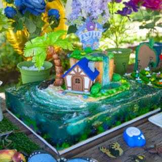 sculpted animal crossing cake sitting on a table with presents and decorations surrounding it