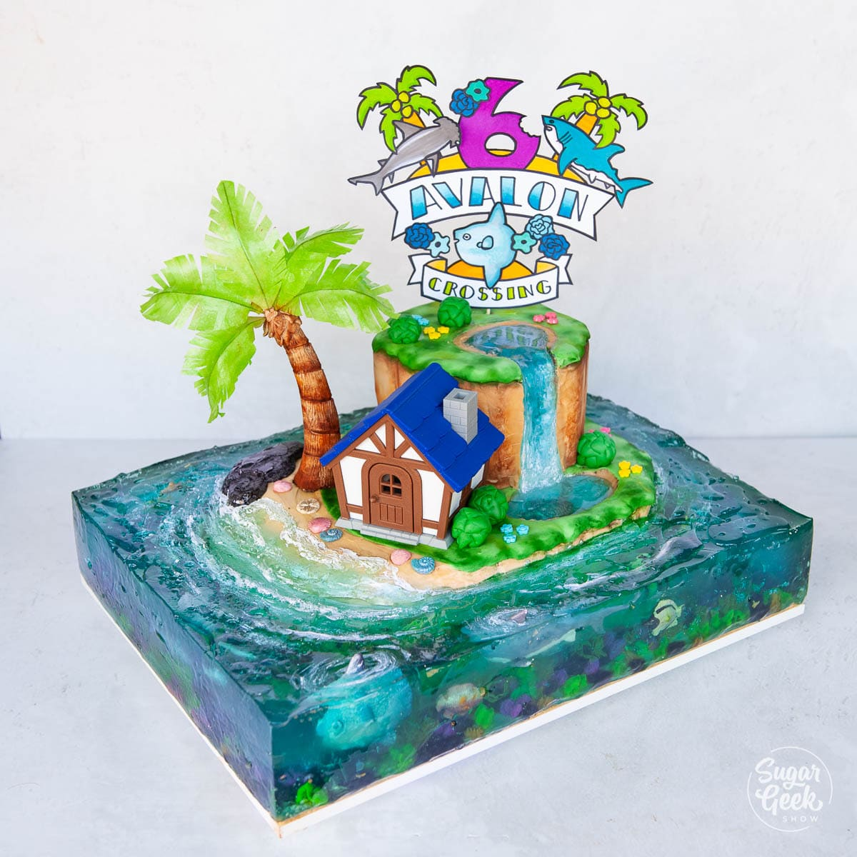 animal crossing cake with jelly ocean and paper sign topper