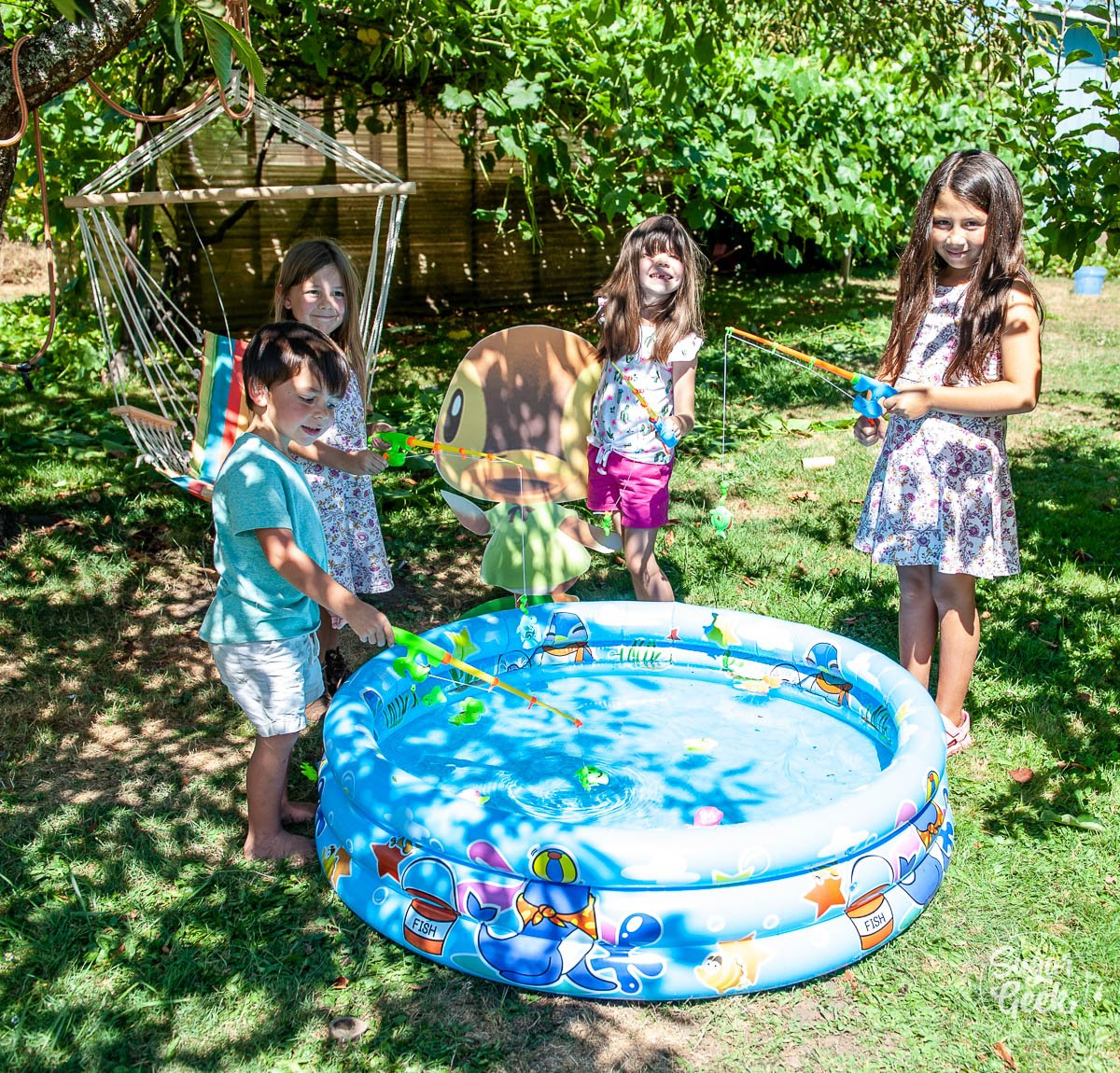 kids fishing with toy fishing poles in a kiddie pool