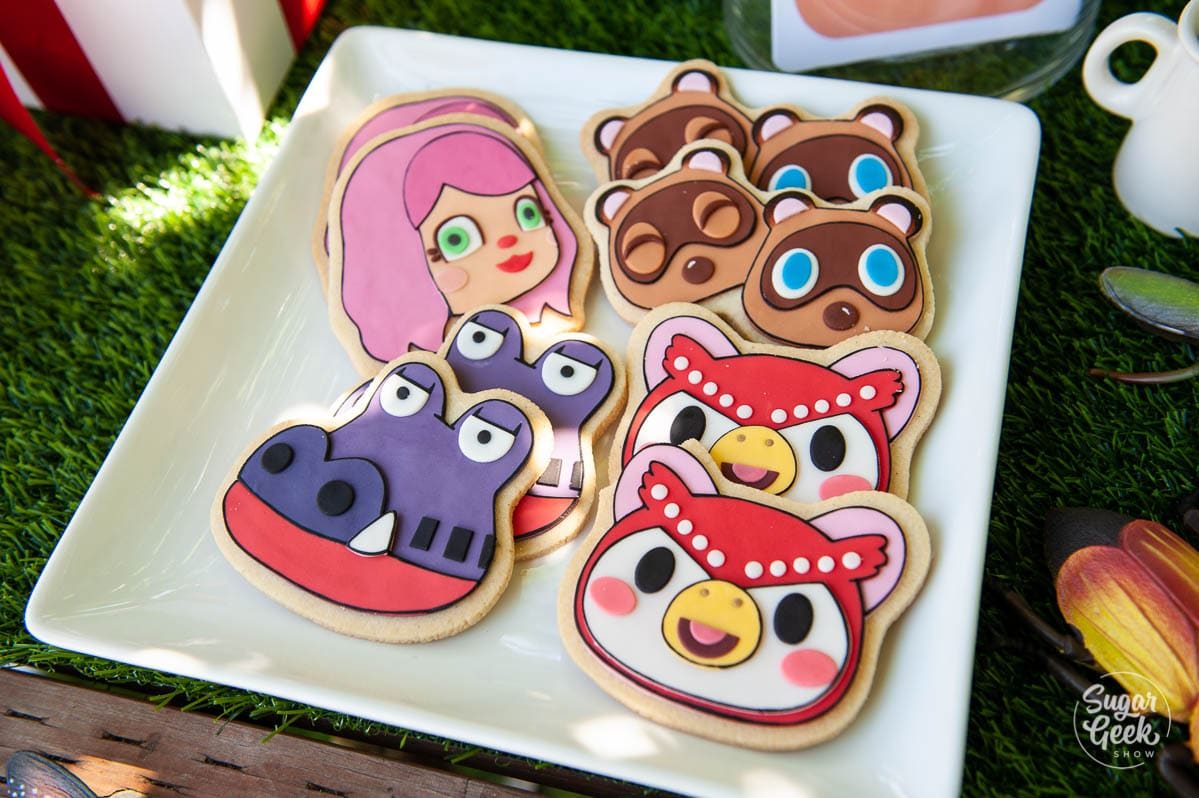 animal crossing sugar cookies on a white plate