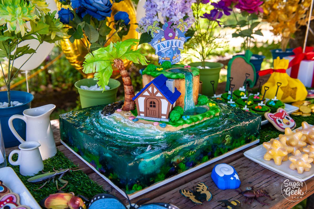 animal crossing cake surrounded by party decorations