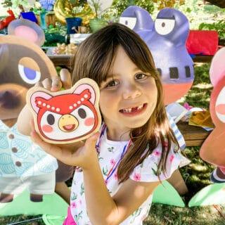 girl holding celeste sugar cookie
