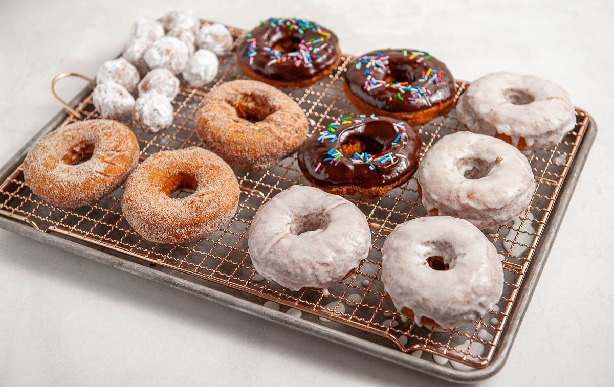donuts on a cooling rack on a sheet pan