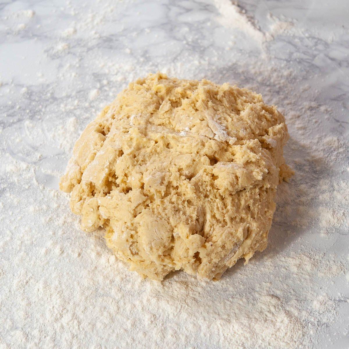 cake donut dough on a floured countertop