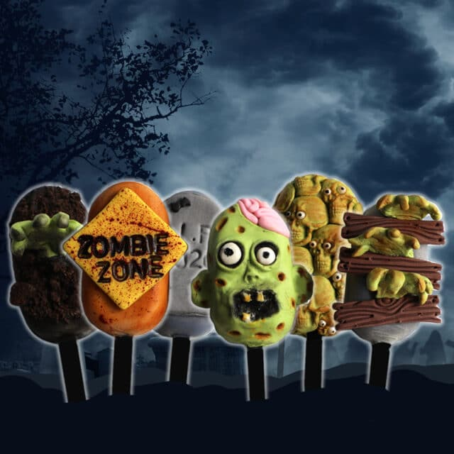 halloween-themed cakesicles that look like tombstones, zombies, skulls and hands