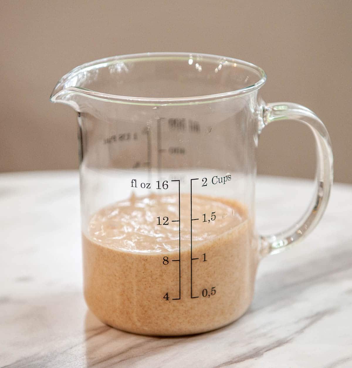 sourdough discard in a glass measuring cup