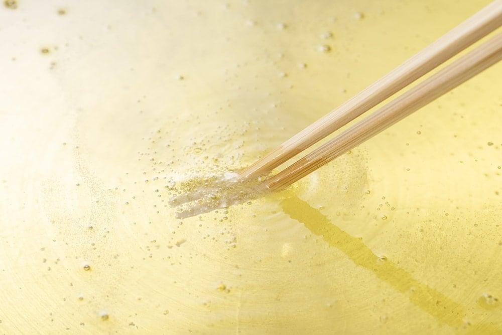 wooden chopsticks in hot oil